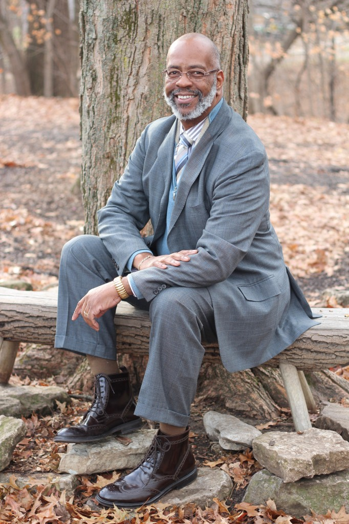 James Garrett Jr. Executive director Indiana Commission on the Social Status of Black Males Layering isn't just for putting random pieces of clothing together. You can still get a layered effect with a standard suit. (Suit, Polo Ralph Lauren; shirt, Aster; sweater, Cornellani; tie, Tino Cojura; boots, Stafford wingtips) - stylist's private collection